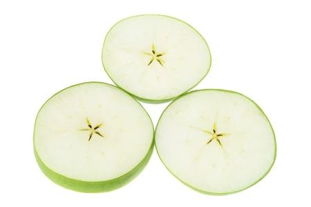 granny smith apple: Slices of Granny Smith Apple on White Background