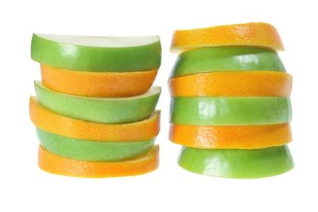 Slices of Apple and Orange on White Background photo