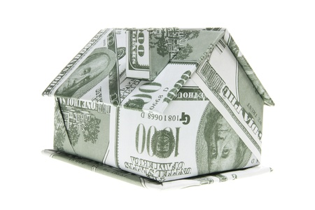 Miniature Paper Building on White Background photo
