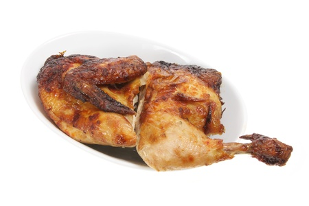 halves: Roast Chicken on Dish with White Background Stock Photo