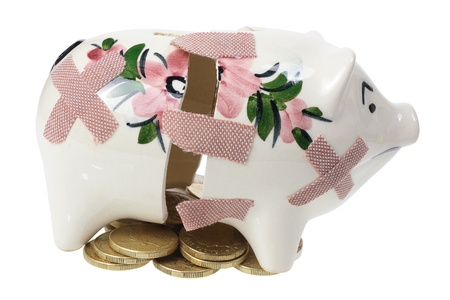 Broken Piggy Bank and Coins on White Background photo