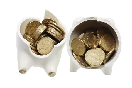 Broken Piggy Bank and Coins on White Background Stock Photo - 9842421