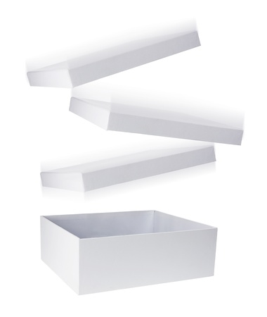 Cardboard Box with Flying Lid on White Background photo