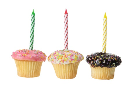 Cup Cakes with Birthday Candles on white Background photo