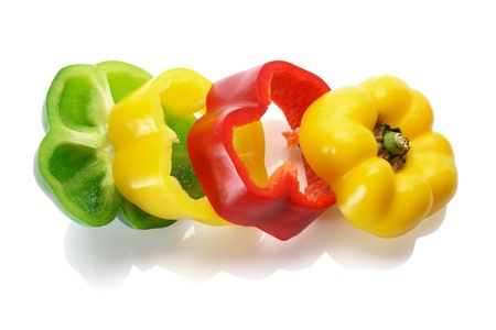 Slices of Capsicums on White Background photo