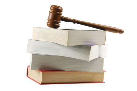 Wooden Gavel on Books with White Background photo