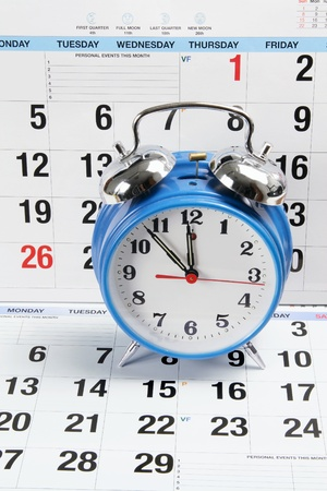 timing: Alarm Clock with Calendar Pages Stock Photo