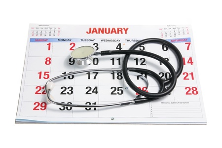 cut out device: Calendar and Stethoscope on White Background Stock Photo