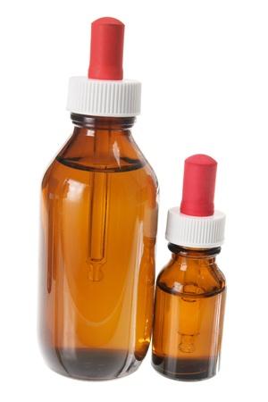 Bottles of Massage Oil on White Background photo