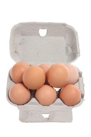 Eggs on Egg Carton with White Background photo