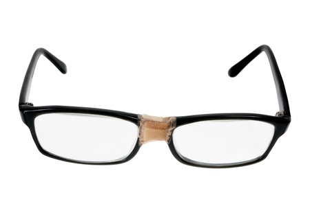 Broken Eyeglasses on White Background photo