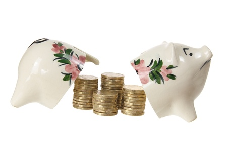 Broken Piggy Bank with Coins on White Background photo