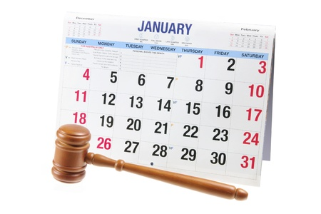 Gavel and Calendar on White Background photo