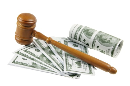 Gavel and Dollar Notes on White Background photo