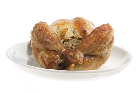 Roast Chicken on Plate with White Background photo