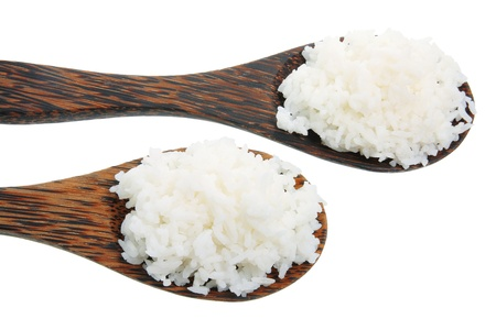 Wooden Spoons with Rice on White Background photo