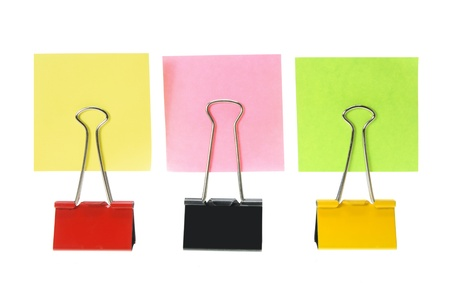 Sticky Notes and Paper Clips on White Background photo