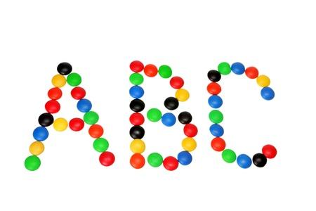 Chocolate Bean Alphabets on White Background photo