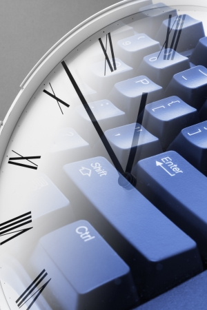 appointment: Composite of Clock and Keyboard Stock Photo