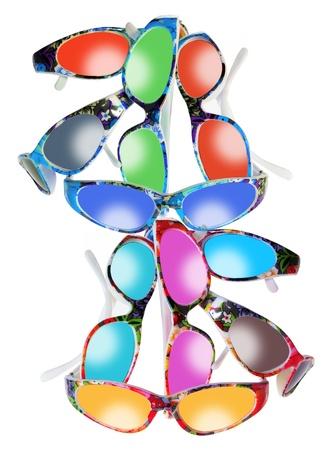 novelties: Stack of Sunglasses on White Background Stock Photo