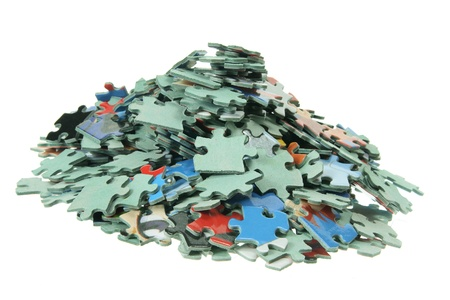 piezas de rompecabezas: Piezas de puzzle en el fondo blanco Foto de archivo