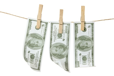 Clothes Line with Dollar Notes on White Background photo