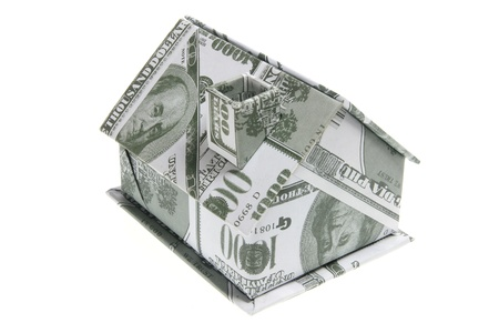 Miniature Banknote House on White Background photo