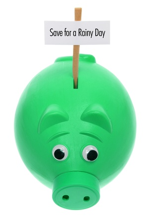 Piggy Bank with Sign Board on White Background photo