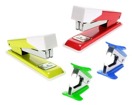 Staplers and Staple Removers on White Background photo