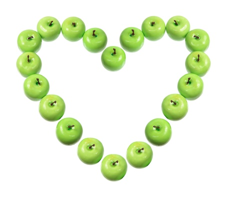 granny smith apple: Green Apples in Heart Shape on White Background