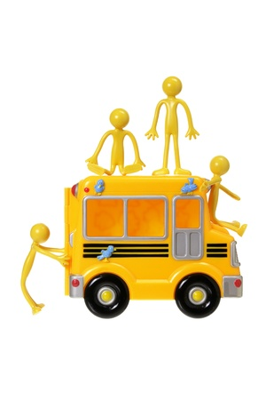 Toy Bus and Rubber Figures on White Background photo