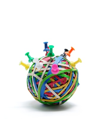 rubberband: Pushpins on Rubberband Ball on White Background