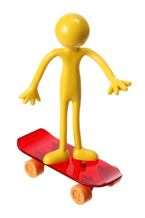 Miniature Figure with Skateboard on White Background Stock Photo - 13377378