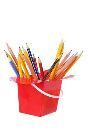 writing implements: Pencils in Plastic Box on White Background Stock Photo