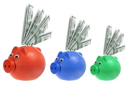 piggybanks: Piggybanks with Banknotes on White Background Stock Photo