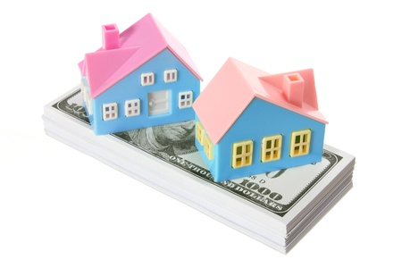 Toy Houses with Dollar Notes on White Background photo