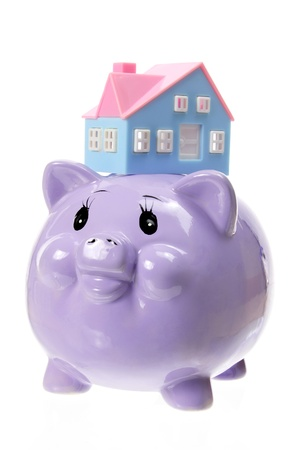 Piggy Bank and Toy House on White Background photo