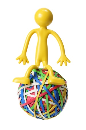 gridlock: Rubber Bands Ball with Figure on White Background Stock Photo