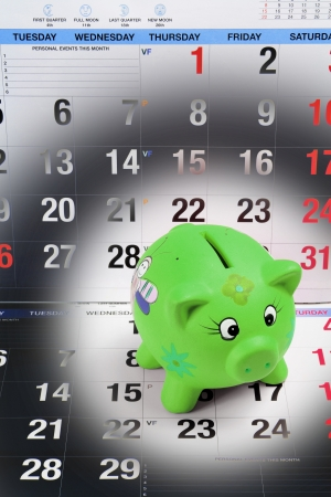 Piggy Bank on Calendar Pages photo