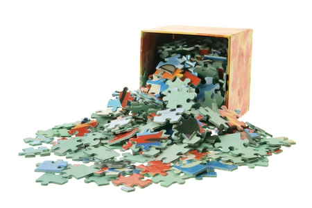 jumble: Jigsaw Puzzle Pieces and Box on White Background