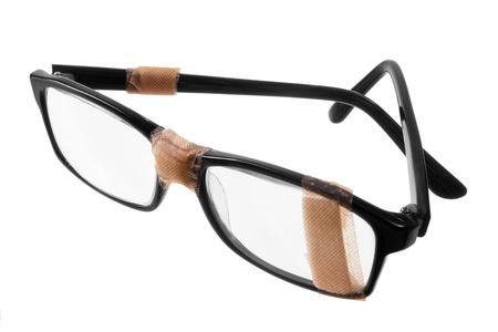 spec: Broken Eye Glasses on White Background