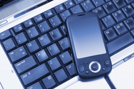 Close Up of Smart Phone on Laptop Stock Photo - 14317408