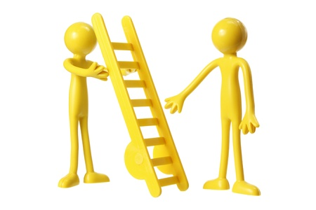 Rubber Figures with Ladder on White Background