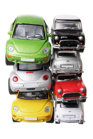 toy car: Stacks of Car Models on White Background Stock Photo