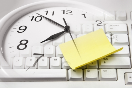 Composite of Clock and Computer Keyboard  photo