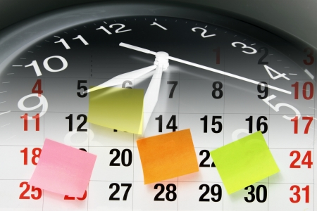 Composite of Clock and Calendar Page Stock Photo