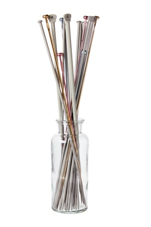Knitting Needles in Bottle on White Background photo