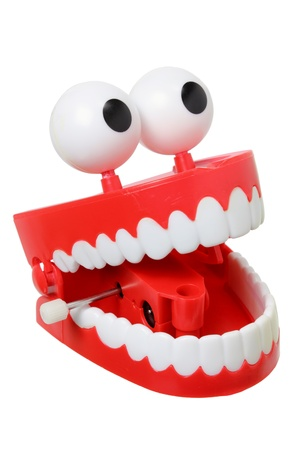 denture: Chattering Teeth on White Background