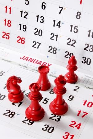 Chess Pieces on Calendar Stock Photo - 15983754