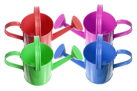 still water: Watering Cans on White Background Stock Photo